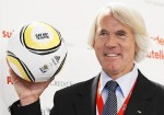 Dvorak, Chief Medical Officer of FIFA poses for photographers as he presents a ball during news conference in Crans Montana
